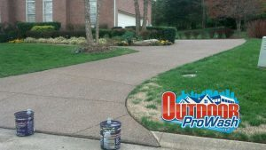 exposed aggregate driveway pressure washing and sealing service